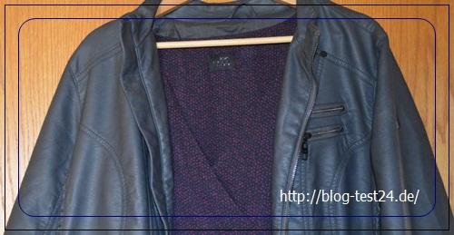 Auch mit Kleid, sieht eine Lederjacke gut aus.